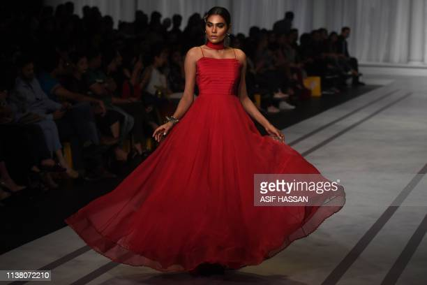 A model presents a creation by Pakistani designer Mona Imran on the second day of the 'Hum Showcase' Fashion Week in Karachi on April 19 2019