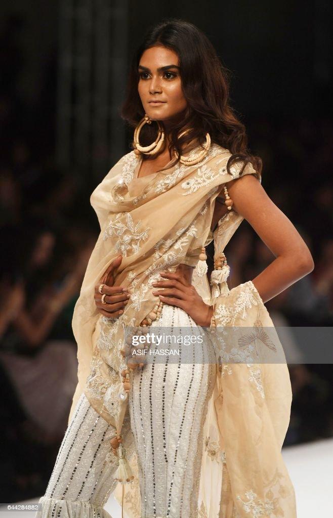 f3727bd7f5 A model presents a creation by Pakistani designer Nida Azwer on the ...