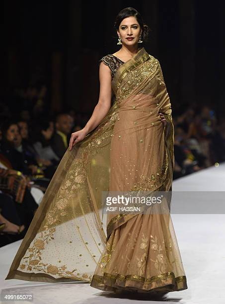A model presents a creation by Pakistani designer Obaid Shiekh on the second day of the Fashion Pakistan Week in Karachi on November 29 2015 AFP...