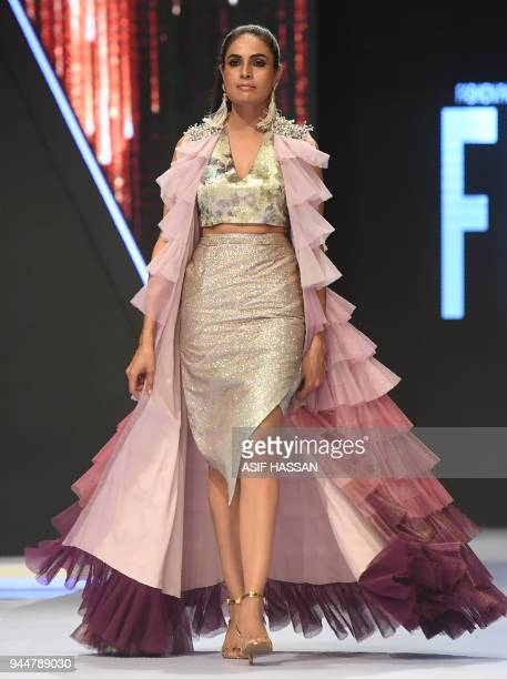 A model presents a creation by Pakistani designer Rozina Munib on the final day of the Fashion Pakistan Week Spring/Summer 2018 in Karachi on April...