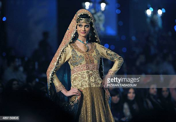 A model presents a creation by Pakistani designer Somal Halepoto during the second day of the Bridal couture week in Karachi on May 10 2014 AFP...