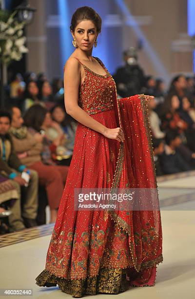 Model presents a creation by Pakistani designer Tena Durrani on first day of Bridal Couture Fashion Week in Lahore Pakistan on December 11 2014