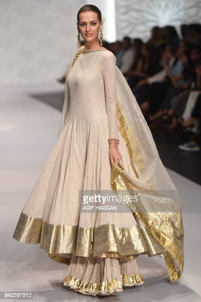 A model presents a creation by Pakistani designer Umar Sayeed on the final day of the 'Hum Showcase' Fashion Week in Karachi on late March 30 2018 /...