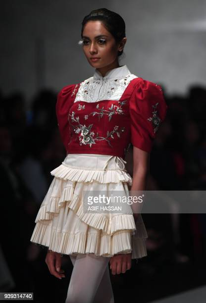 A model presents a creation by Pakistani designer Zaheer Abbas on the first day of the Hum Showcase Fashion Week in Karachi on March 28 2018 / AFP...