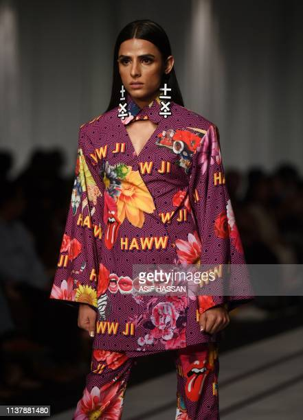 A model presents a creation by Pakistani fashion brand 9 Lines on the first day of the 'Hum Showcase' Fashion Week in Karachi on April 18 2019
