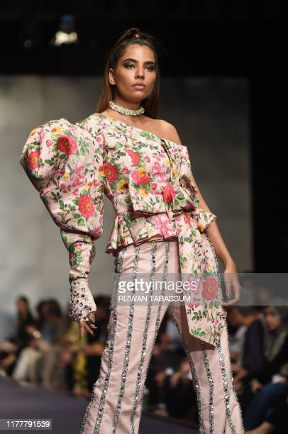 Model presents a creation by Pakistani Fashion brand Alkaram on the first day of the Fashion Pakistan Week Winter Festive 2019 in Karachi on October...