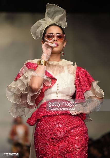 Model presents a creation by Pakistani fashion designer Hassan Riaz on the first day of the Fashion Pakistan Week Winter Festive 2019 in Karachi on...