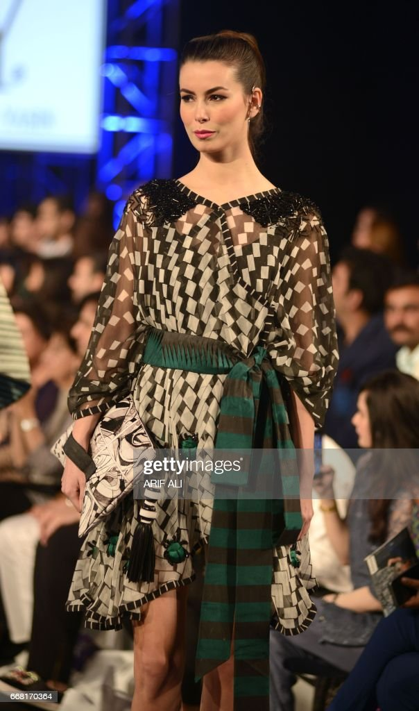 A model presents a creation by Pakistani fashion designer