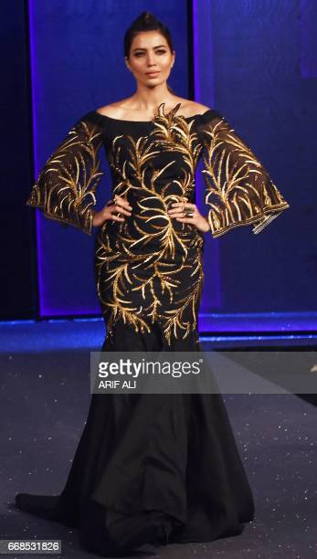 92ffe7f518 A model presents a creation by Pakistani fashion designer Tena Durrani on  the second day of