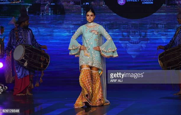 A model presents a creation by Pakistani fashion designer Wardha Saleem on the final day of the Fashion Bridal Couture Week in Lahore on November 27...