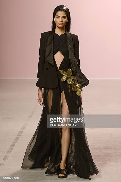 A model presents a creation by Pascal Millet during the 2015 Spring/Summer readytowear collection fashion show on September 23 2014 in Paris AFP...