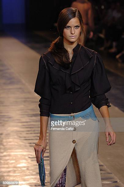 A model presents a creation by Patachou during the Fall/Winter 2005 collection of the Sao Paulo Fashion Week at Parque Ibirapuera in Sao Paulo Brazil...