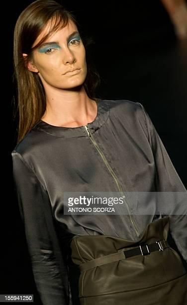 A model presents a creation by Patachou during the Rio Fashion Week 2013 Autumn/ Winter collection on November 9 2012 in Rio de Janeiro Brazil