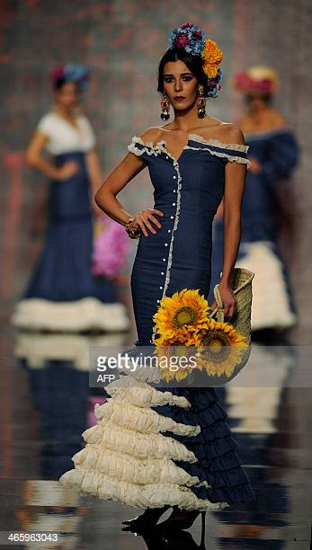 A model presents a creation by Patricia Bazarot during the first day of the SIMOF in Sevilla on January 30 2014 AFP PHOTO/ GOGO LOBATO