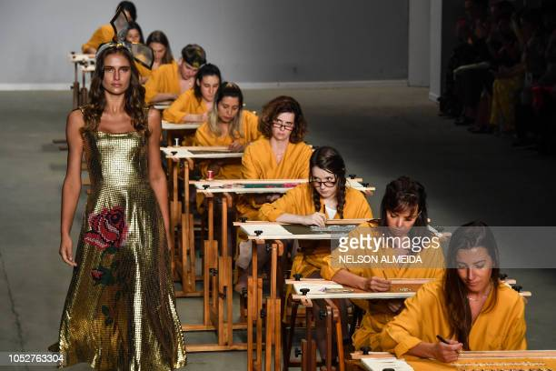 TOPSHOT A model presents a creation by Patricia Viera during the Sao Paulo Fashion Week in Sao Paulo Brazil on October 22 2018