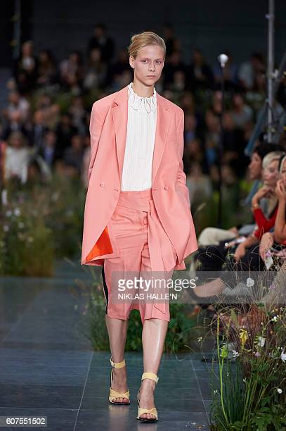 A model presents a creation by Paul Smith during the 2017 Spring / Summer catwalk show at London Fashion Week in London on September 18 2016 / AFP /...