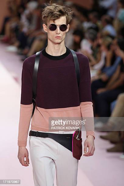 A model presents a creation by Paul Smith during the men's spring/summer 2014 readytowear fashion show on June 30 2013 in Paris AFP PHOTO / PATRICK...