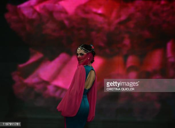 A model presents a creation by 'Provincia de Granada' during the Simof 2020 in Seville on February 1 2020