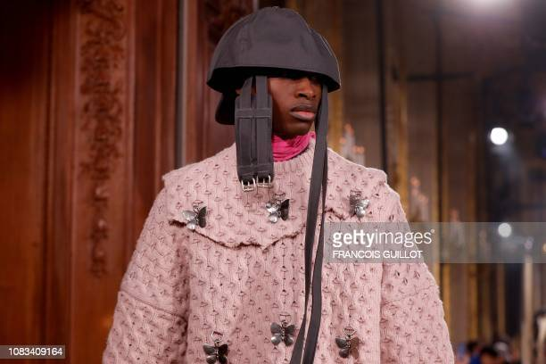 Model presents a creation by Raf Simons during the men's Fashion Week for the Fall/Winter 2019/2020 collection in Paris on January 16, 2019.