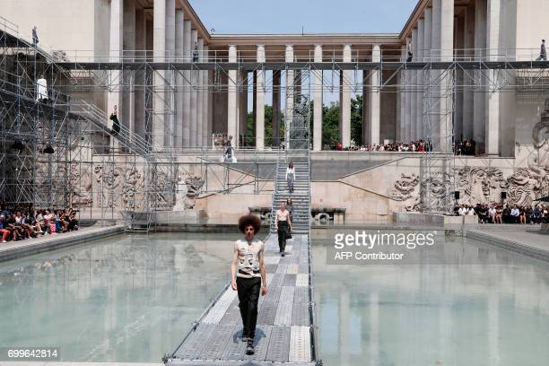 A model presents a creation by Rick Owens during the Men's Fashion Week for the Spring/Summer 2018 collection in Paris on June 22 2017 / AFP PHOTO /...