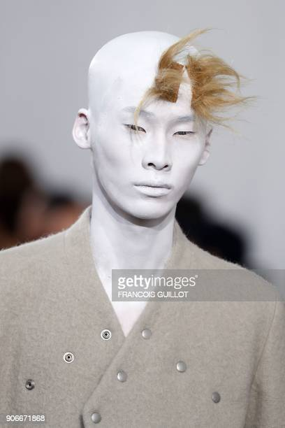 Model presents a creation by Rick Owens during the men's Fashion Week for the Fall/Winter 2018/2019 collection in Paris on Janaury 18, 2018. / AFP...