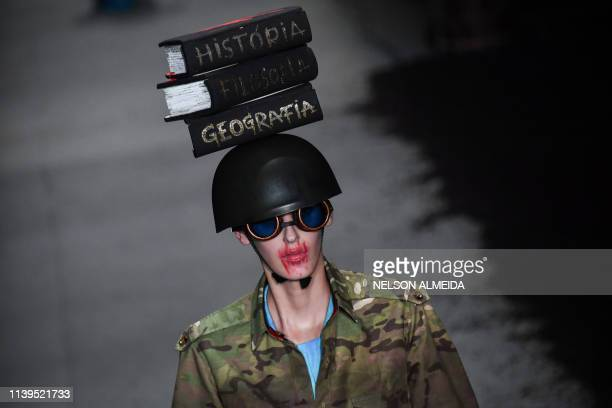 A model presents a creation by Ronaldo Fraga during the Sao Paulo Fashion Week in Sao Paulo Brazil on April 26 2019