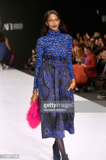 Model presents a creation by Ruff Tung, which has become known for its plus-size designs, on the catwalk on the second day of the Cape Town...