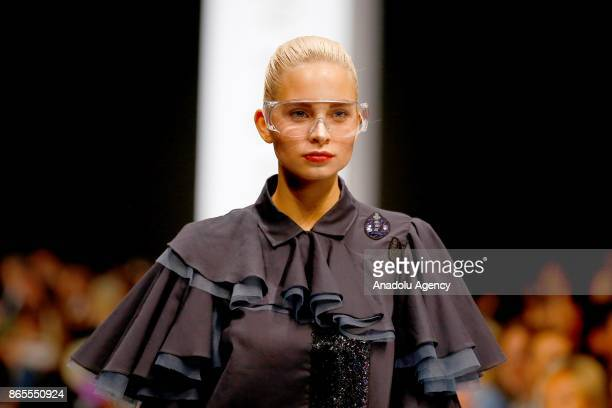 A model presents a creation by Russian designer Julia Dalakian during the MercedesBenz Fashion Week in Moscow Russia on October 23 2017