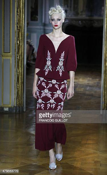A model presents a creation by Russian fashion designer Ulyana Sergeenko during the Fall/Winter 20152016 haute couture fashion show in Paris on July...
