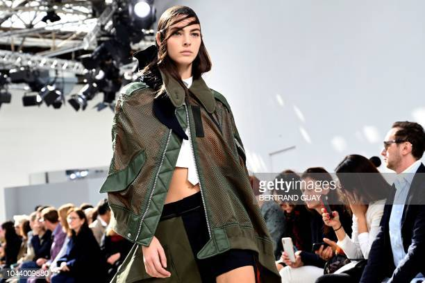 A model presents a creation by Sacai during the SpringSummer 2019 ReadytoWear collection fashion show in Paris on October 1 2018