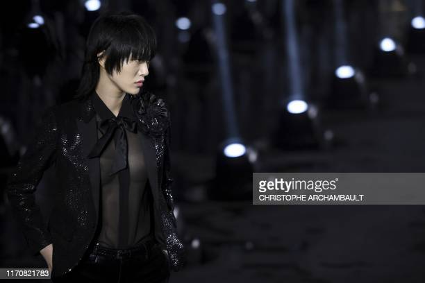 TOPSHOT A model presents a creation by Saint Laurent during the Women's SpringSummer 2020 ReadytoWear collection fashion show in Paris on September...