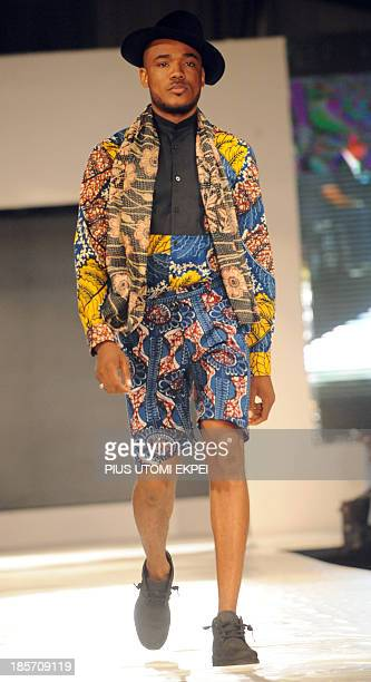 A model presents a creation by Samson Shoboye during the Lagos Fashion and Design Week on October 23 2013 The fourday Lagos Fashion and Design Week...