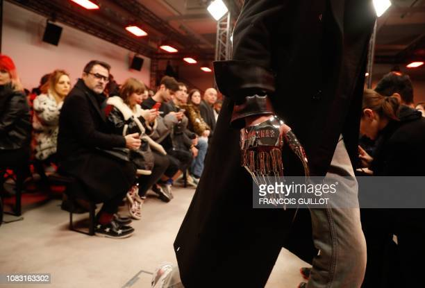 Model presents a creation by Sankuanz, during the men's Fall/Winter 2019/2020 collection fashion show in Paris on January 15, 2019.