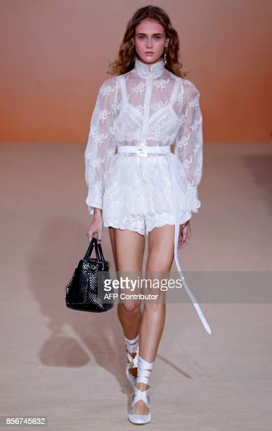 A model presents a creation by Shiatzy Chen during the women's 2018 Spring/Summer readytowear collection fashion show in Paris on October 2 2017 /...