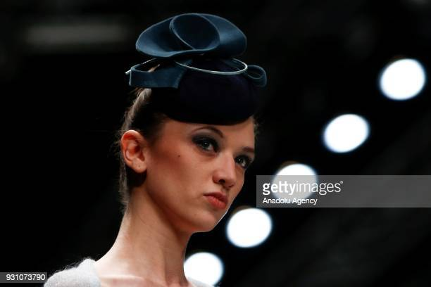A model presents a creation by Slava Zaitsev presents Fashion Laboratory during the MercedesBenz Fashion Week in Moscow Russia on March 12 2018