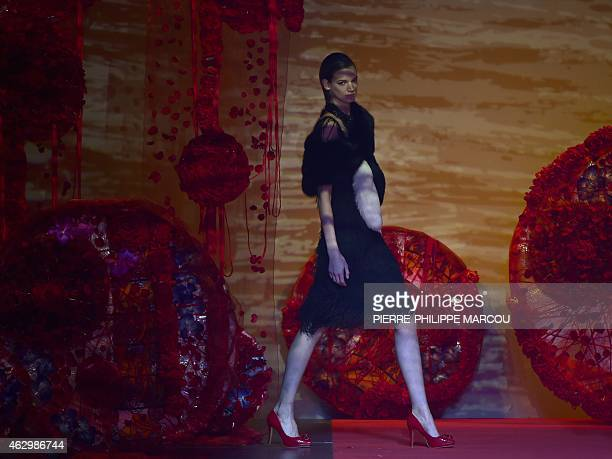 A model presents a creation by Spanish designer Francis Montesinos of the AutumnWinter 20152016 collection fashion show during the Mercedes Benz...