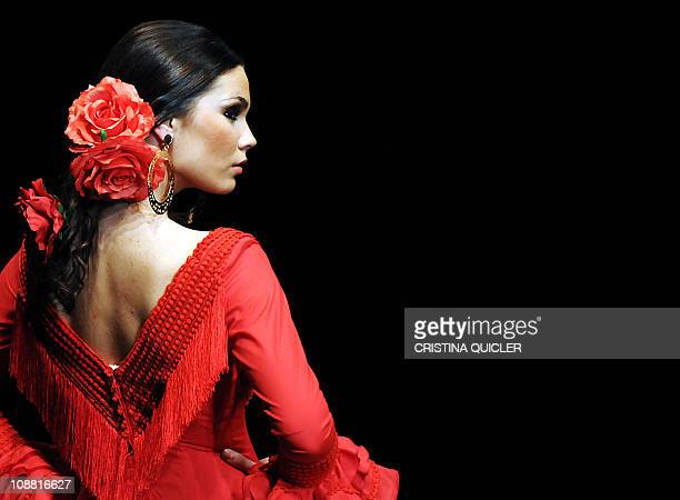 A model presents a creation by Spanish designer Pilar Vera during the SIMOF 2011 on February 3 in Sevilla AFP PHOTO/ CRISTINA QUICLER