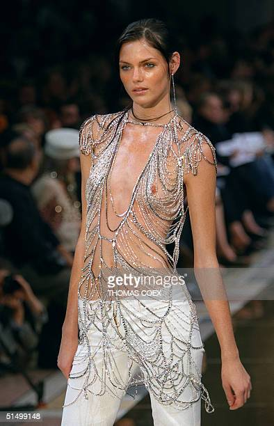 A model presents a creation by Stella Mc Cartney for the Chloe SpringSummer 2000 readytowear collection 06 October 1999 at the Petit Palais museum in...