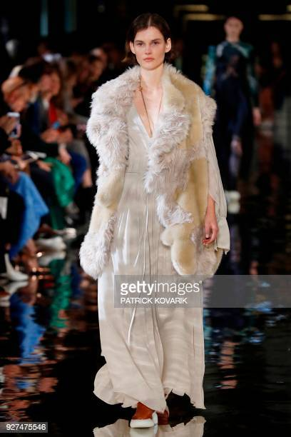 A model presents a creation by Stella McCartney during the 2018/2019 fall/winter collection fashion show on March 5 2018 in Paris / AFP PHOTO /...