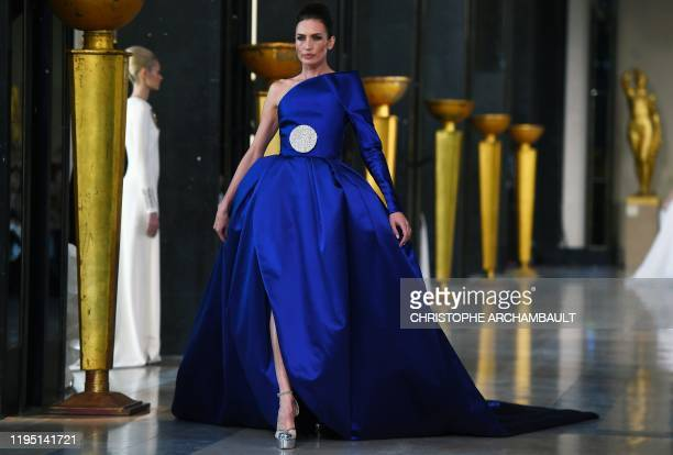 Model presents a creation by Stephane Rolland during the Women's Spring-Summer 2020/2021 Haute Couture collection fashion show in Paris, on January...