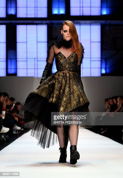 A model presents a creation by the label 'Irene Luft' during the Fashion Week in Berlin on January 17 2018 / AFP PHOTO / dpa / Britta Pedersen /...