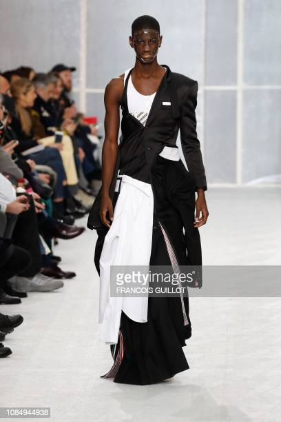 A model presents a creation by Thom Browne during the men's Fall/Winter 2019/2020 collection fashion show in Paris on January 19 2019