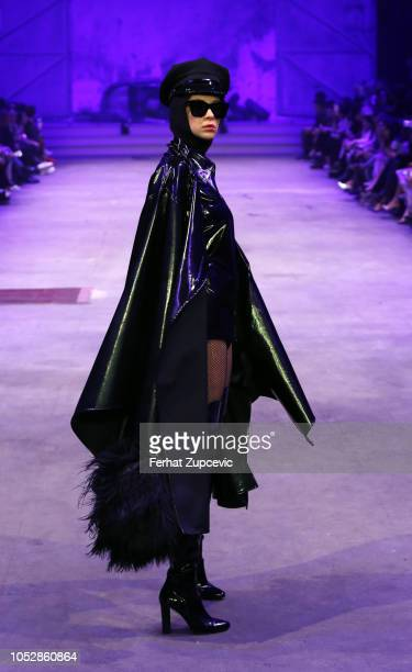 A model presents a creation by Turkish designer Hakan Akkaya's Fall/Winter 1920 Fashion Show at Haskoy Yarn Factory on October 23 2018 in Istanbul...