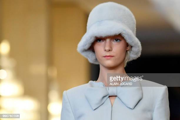 A model presents a creation by Ulyana Sergeenko during the 20182019 Fall/Winter Haute Couture collection fashion show in Paris on July 3 2018