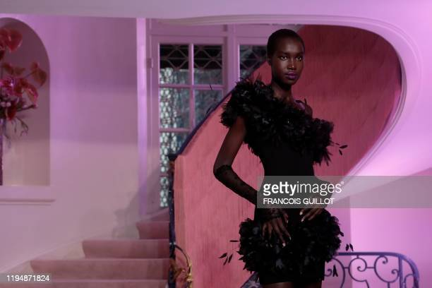 Model presents a creation by Ulyana Sergeenko during the rehearsal of the Women's Spring-Summer 2020/2021 Haute Couture collection fashion show in...