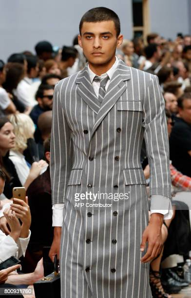 Model presents a creation by US designer Thom Browne, during the Men's Fashion Week for the Spring and Summer 2018 collection in Paris, on June 25,...