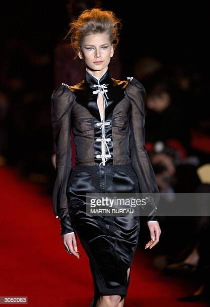 A model presents a creation by US designer Tom Ford for Yves SaintLaurent during the presentation of Autumn/Winter 200405 collections at the Paris...