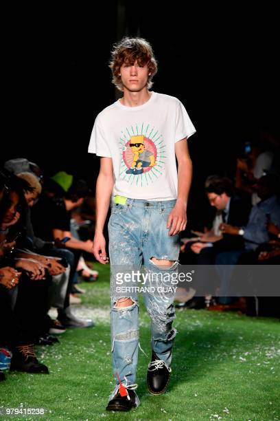 17fc09793ee7 A model presents a creation by US designer Virgil Abloh from OFFWHITE  fashion house on June