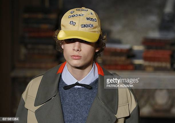 A model presents a creation by Valentino during men's Fashion Week for the Fall/Winter 2017/2018 collection in Paris on January 18 2017 / AFP /...