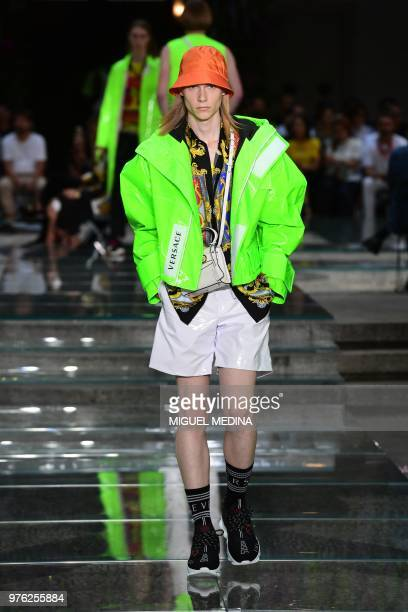 A model presents a creation by Versace during the men women's spring/summer 2019 collection fashion show in Milan on June 16 2018